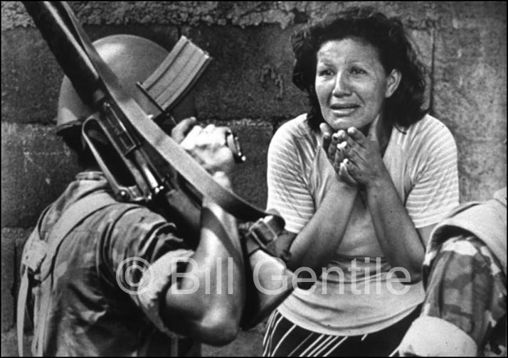 Woman pleads for assistance from National Guardsman in Managua. 1979.