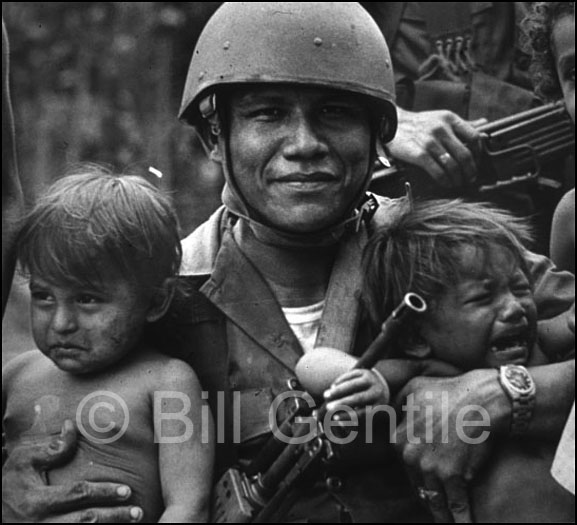 A National Guardsman in the city of Nindiri poses with two children. 1979.